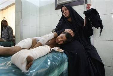Amir Ahmed severely burned in bombing 10 years old being comforted by mother