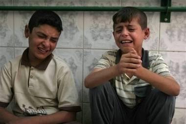 Two boys crying baqouba hospital