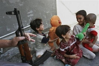 Children in Baghdad Play Under The Watchful Eye of Their Father.