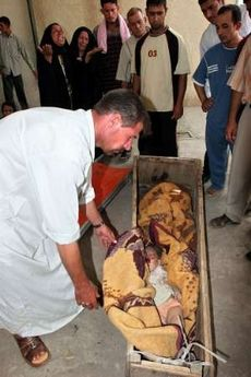 Baby killed rocket attack Baquba being placed into coffin