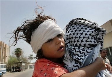 Young child injured in bombing being carried home by her father after hospital treatment