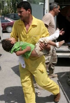 A child injured in a mortar attack in Muqdayiya is brought into baquba hosptial by an attendant