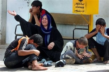 Mother and children mourning Wisam Ali, 13, who was killed on the way to the Imam Moussa Kadhim shrine