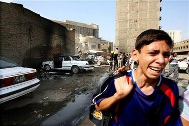 Boy leaving scene of bombing in Qurtuba Square October 12th 2006
