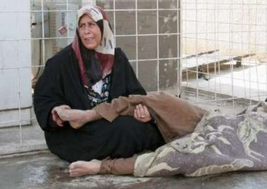 Woman crying holding the corpse of her son Baquba October 28th 2006