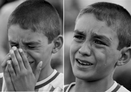 Baghdad November 4th 2006 boy crying at his the funeral of his three sisters who were killed in a car bomb attack yesterday