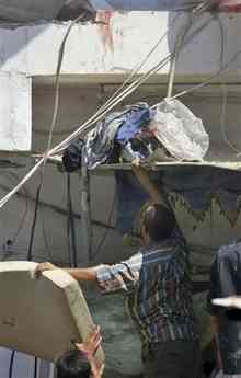 Body being recovered from second storey after al-ula bombing