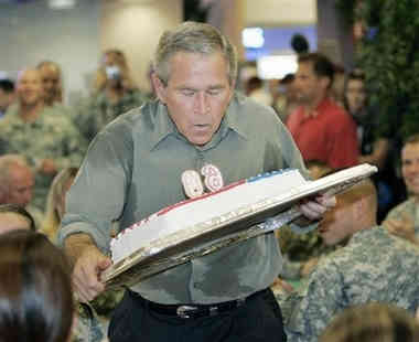 George Bush with cake July 4th 2006