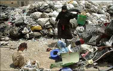 Mother and daughter working rubbish dump Baghdad July 4th 2007