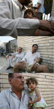 composite20060727_Karrada_Baghdad_Yakim_aged_2_held_by_her_father_rocket_attack_both_brothers_killed.jpg