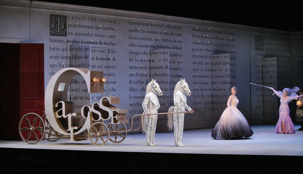 Joyce DiDonato as Cendrillon and Eglise Gutierrez as La Fe, Cendrillon, Santa Fe Opera, directed by Laurent Pelly, sets by Barbara de Limburg, costumes by Laurent Pelly and Jean-Jacques Delmotte, photo by Ken Howard &#169; 2006