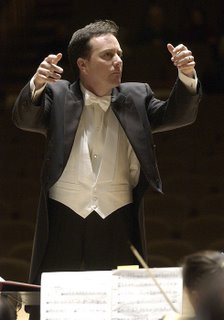 Conductor Ryan Brown, employing his trademark two-finger technique
