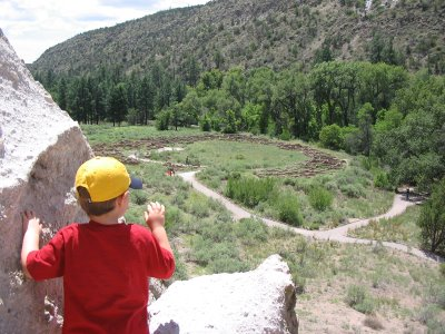 Mini-Critic at Bandelier, from the cliff dwellings, overlooking the Tyuonyi pueblo ruin