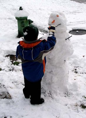 Mini-Critic makes a snowman, February 12, 2006