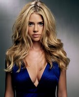 Denise Richards shows off her assets -- and we're not talking about her eyes!