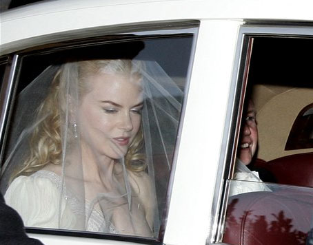 Nicole Kidman wears a white wedding dress on her way to wed Keith Urban.