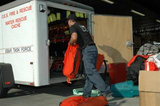 LAFD Captain loads USAR water rescue gear for Hurricane Katrina.  © Ryan Ling, FirelinePhoto.com