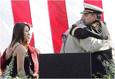 Chief Bamattre embraces Julia's husband Paul. Photo by Hans Gutknecht, Daily News. CLICK TO VIEW MORE