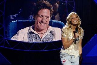 Mandy Moore singt in Hugh Grants fiktiver Castingshow American Dreamz, in der US-Präsident Dennis Quaid bald einen Gastauftritt haben soll.