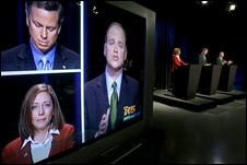 Bruce Guthrie, Libertarian (top left in screen, standing at middle podium) debates the Democratic and Republican candidates for Washington Senate