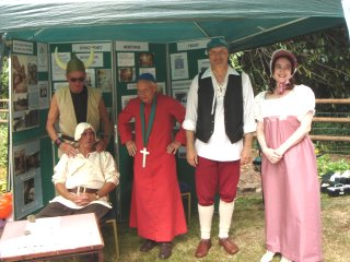 Trust members dressed in a variety of historical costumes