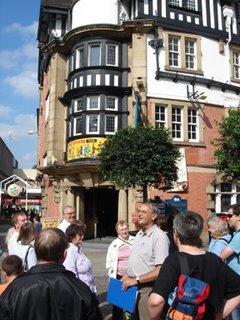 Kevin Dranfield addresses the group outside The While Lion, Kath Taylor looks on