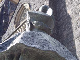 Close up of biretta and cape on the statue of Archbishop Mannix