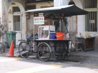 Pedal-powered hawker's cart