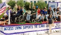 Parade float with a dozen waving people on it, some using wheelchairs