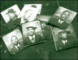 Scattering of photographs of well-dressed black man