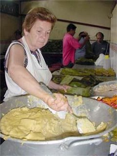 Ana Valverde fills chicken tamales. Photo by A.M. Costa Rica