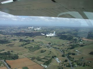 Formation picture just south of NZAR. 1xC172N [camera ship], 3xAA1C