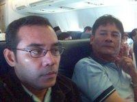 Di atas pesawat : saya dan Tulang Godang yang sering bercanda.