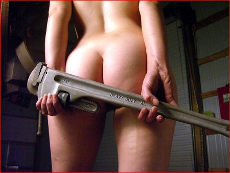 Naked gal showing ass and holding very large tool