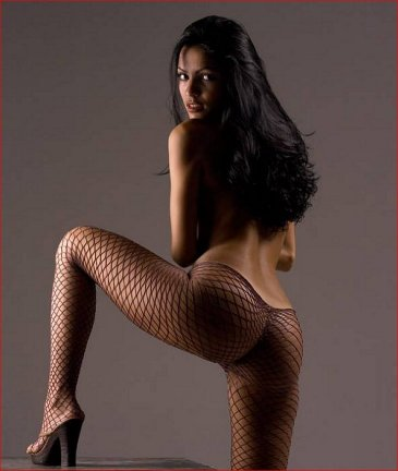 Very sexy brunette in fishnet stockings