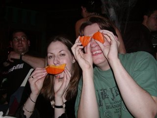 Nat and Rob posing with the removed pumpkin pieces.