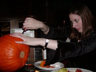 Nat carving a face into the pumpkin