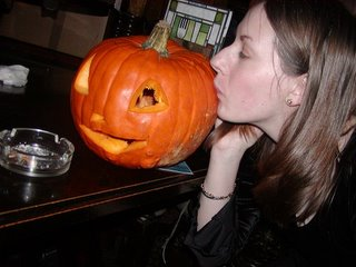 Nat kissing Eric the pumpkin on the cheek