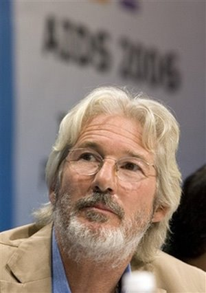 Actor Richard Gere watches a video presentation at the 16th World Aids ...