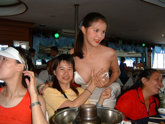 Topless girls touching girls breasts