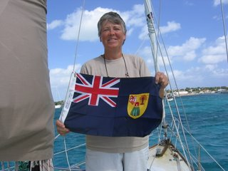 Bev Hoisting the Turks & Caicos Flag