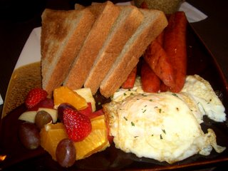 BREAKFAST AT PANYA: 2 eggs (over easy) with wheat toast, portuguese sausages and fruits