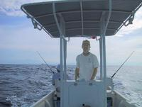 Rob at the helm heading out to blue water fishing
