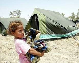 Refugee girl from al-Jihad neighbourhood arrives at refugee camp July 14th 2006