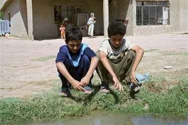 Ahmed and Mohammed Qassim Hamza Ahmed is the boy on the left he's aged 9 Mohammed is aged 11