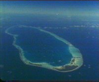 High altitude aerial of Pacific coral island atolls