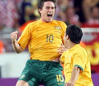 Harry Kewell and Tim Cahill celebrate