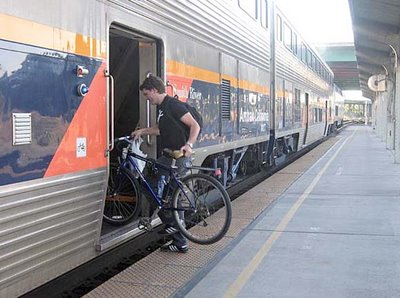 Image of bicyclist loading bike on Capitol Corridor rail car in Sacramento