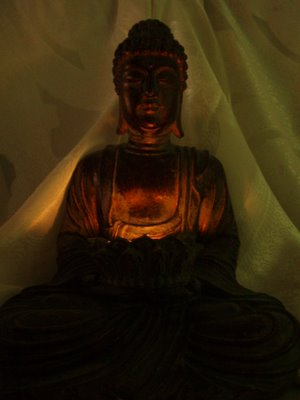 Buddha with candle, (c) KR Silkenvoice 2006