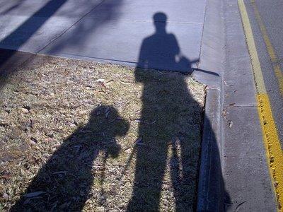 Mwaaaaahhhhhhaaaaaaahahaha...big headed hound is preparing to usurp human from bicycle.....Lock your doooooors dooooogs.